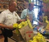 Mayor, Chief bag groceries at ShopRite