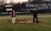 Photo of Mayor Cahn throwing first pitch