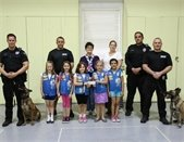 Girl Scouts with K-9 dogs and officers