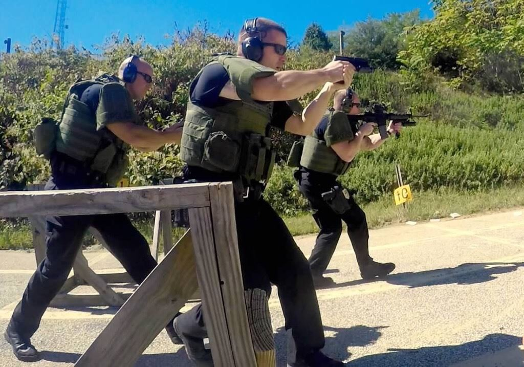 Three Tactical Response Team Members Training, Guns Raised