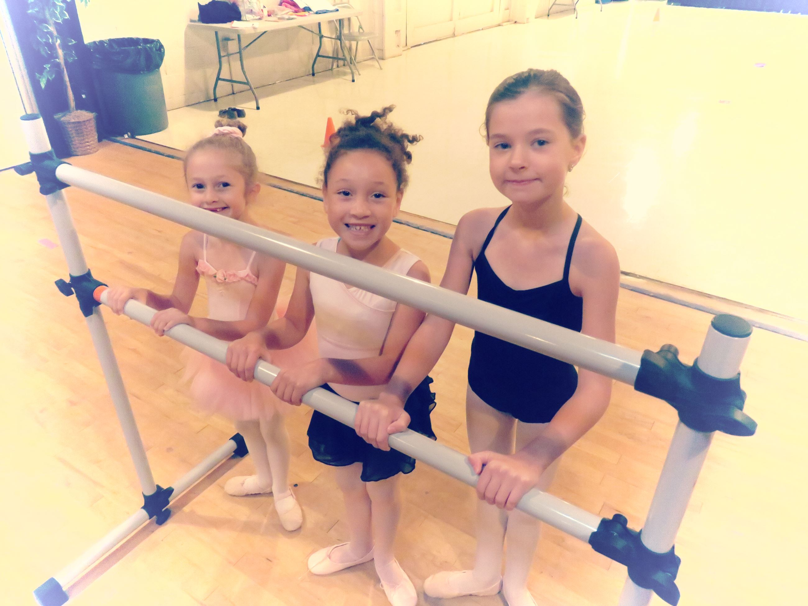 three little girls at ballet bar